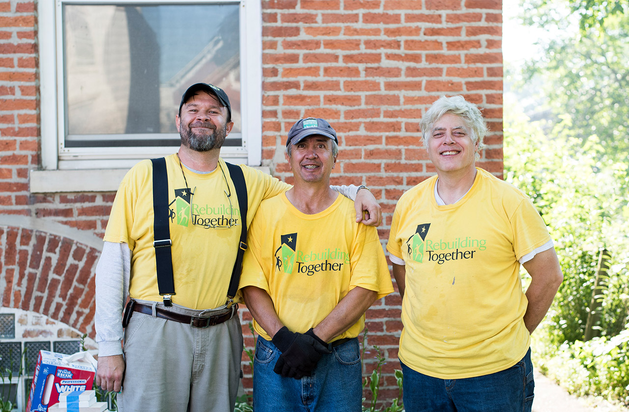 Three house captains smiling at a Rebuilding Together Metro Chicago project.